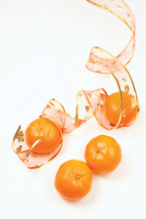 Mandarins on white background with New Year ribbon