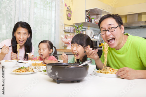 happy asian Family  Eating noodles