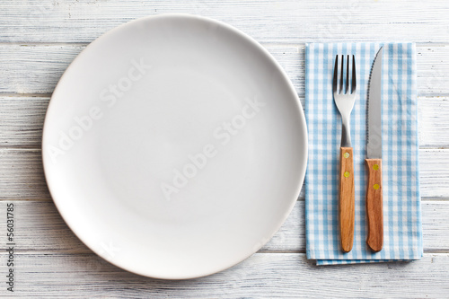 white plate with fork and knife - 56031785