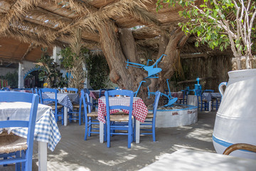 typical Greek taverna with white and blue objects