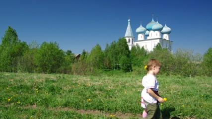 Russian kid on a orthodox church background