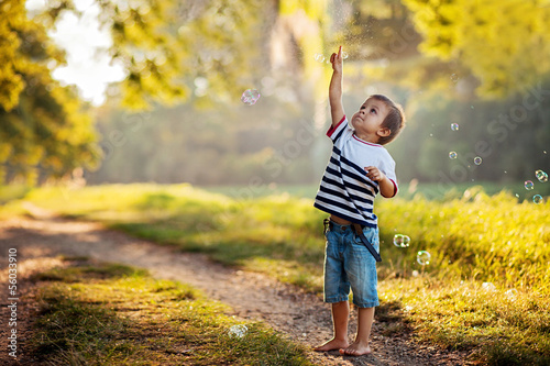 Boy, playing with soap bubbles