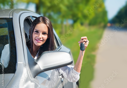 Beautiful woman holding car keys