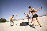 Athletes doing crossfit workout on beach