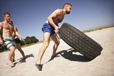Tough crossfit workout on beach