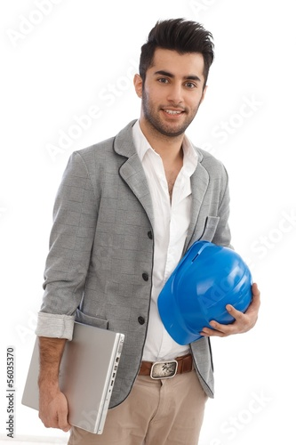 Engineer with laptop and hardhat
