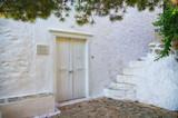 White gate in Hydra island, Greece