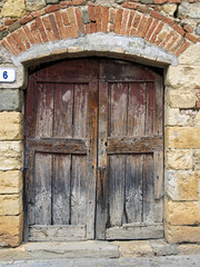 wooden old door of stone house