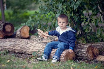 Boy, playing in the forest