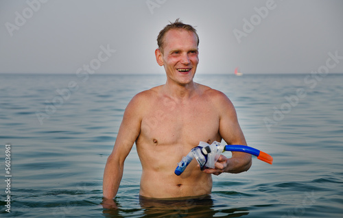 Laughing man with goggles and snorkel