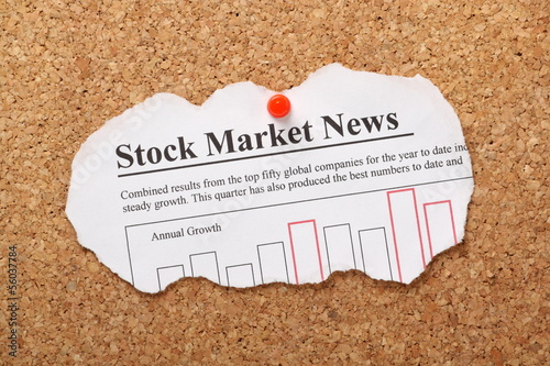 Stock Market Newspaper Clipping on cork board