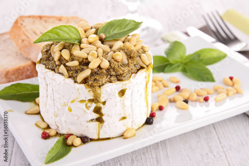 cheese with pesto sauce and pine nut