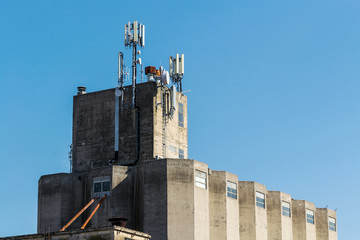 Industrial building with GSM antennas on roof .