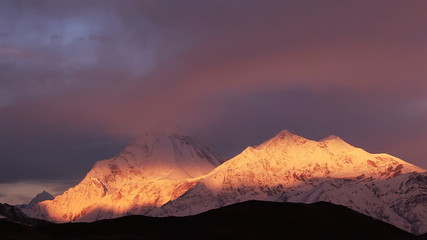 Dhaulagiri peak (8167 m) at sunrise in Himalayas. Time Lapse.