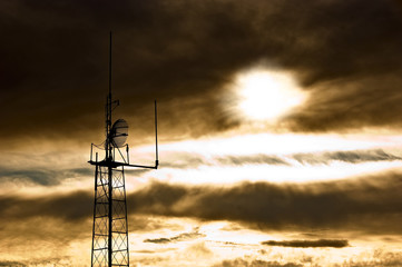 Apocalyptic sky with dramatic clouds and radio antenna.