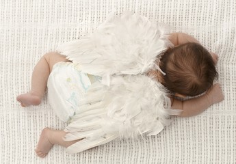 Tiny baby with angel wings