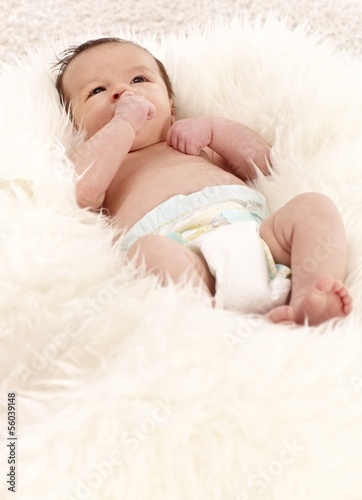 Newborn baby lying on back