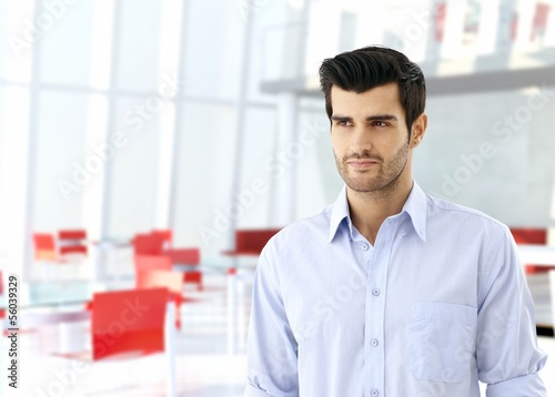 Young man in business hall