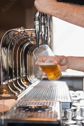 Bartender pulling a pint of beer