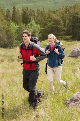 Happy couple setting out on a hike