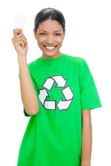 Happy model wearing recycling tshirt holding light bulb