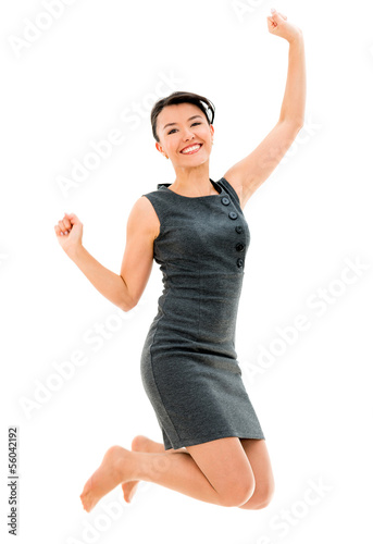 Successful business woman jumping