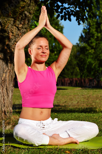Young woman during yoga meditation in the park