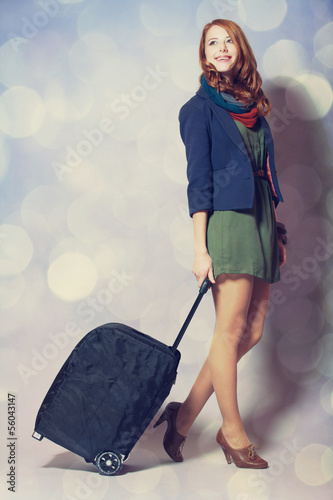 Redhead girl with a suitcase