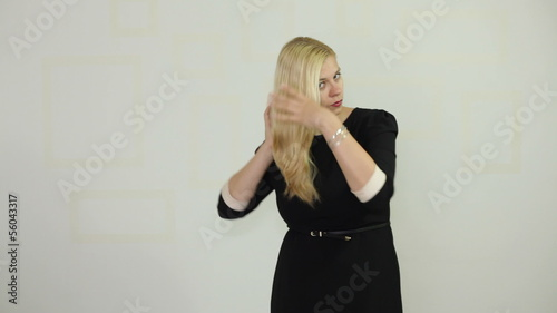 Businesswoman adjusting her blond hair