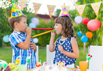 Happy children having fun at birthday party