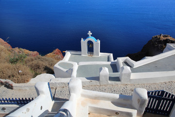 Santorini with churchs bell and sea view in Greece