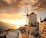 Fototapety Windmill in Santorini against sunset, Greece