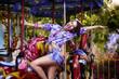 Happy Woman in Amusement Park - Fanfair. Enjoyment