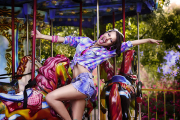 Happy Woman in Amusement Park - Fanfair. Enjoyment