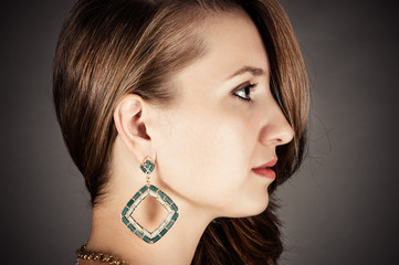 profile of beautiful woman with pierced ears