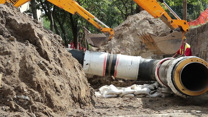District Heating Pipe Laying With Two Excavators