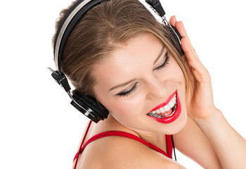 Pretty lady singing and listening song on headphones, isolated