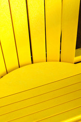 Elements of yellow wooden adirondack chair