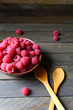 ripe raspberries in a bowl on the boards