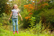Funny toddler european girl with long blond hair jumping