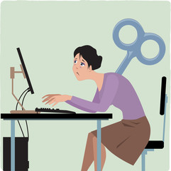Wind-up woman working on the computer