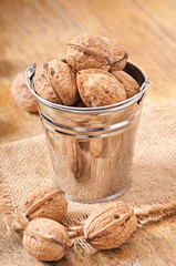 bucket with walnuts