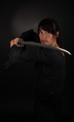 Asian woman holding her sword