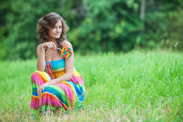 Young beautiful woman sitting on grass