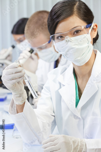 Chinese Asian Woman Scientist With Test Tube in Laboratory