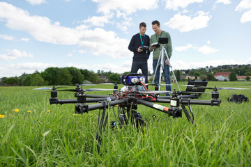 UAV Octocopter And Technicians At Park