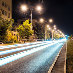 Aspalt road with illuminations in the city