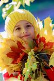 Autumn - lovely girl playing in autumn park
