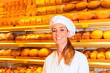 Female baker selling bread in bakery