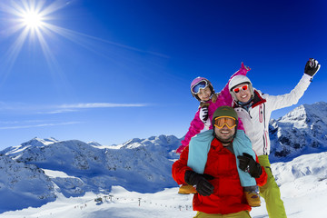 Ski, sun and winter fun - family enjoying winter